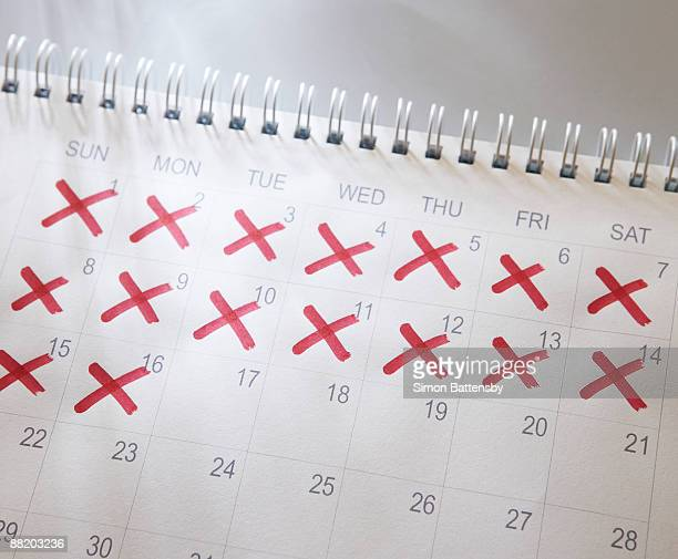 calendar with dates crossed out - countdown stock pictures, royalty-free photos & images