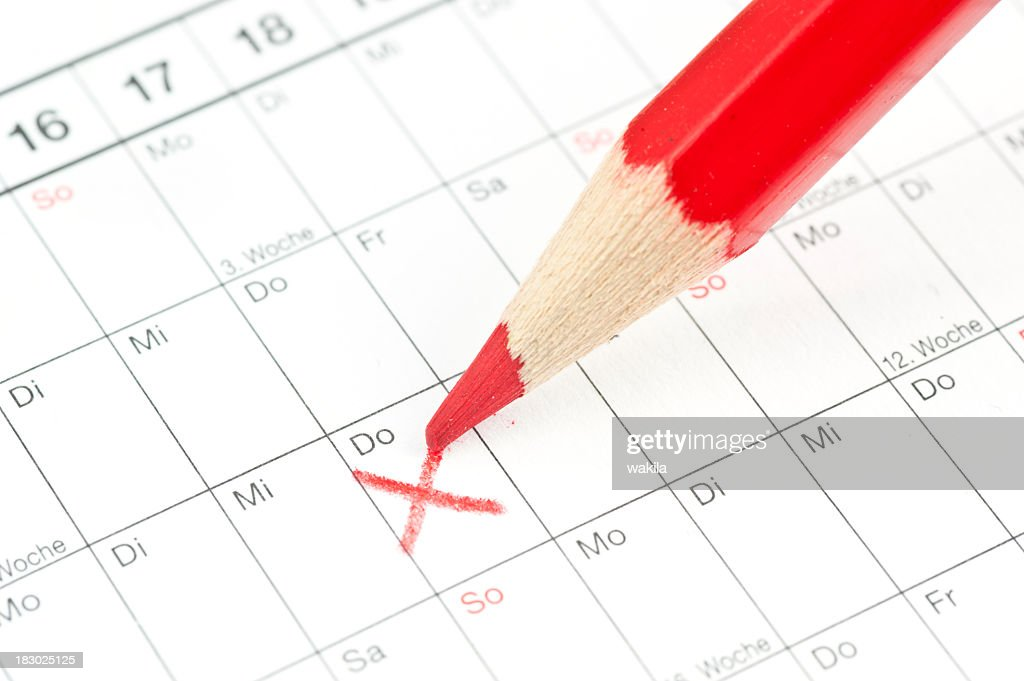 calender red cross on Thursday - German calendar with crayon : Stock Photo