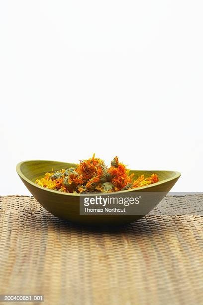 Calendula in wooden bowl