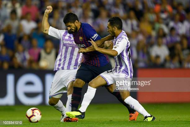 Calero of Valladolid competes for the ball with Luis Suarez of Barcelona during the La Liga match between Real Valladolid CF and FC Barcelona at Jose...