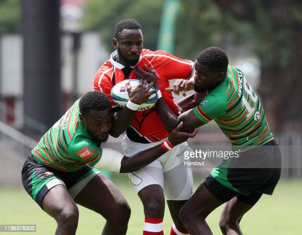 Calestus Bosoka of Ghana challenged by Masabo Mike of Zambia during the 2019 Rugby Africa Mens 7s match between Ghana and Zambia at the Bosman...