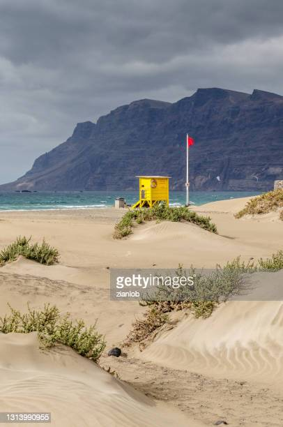 caleta de famara. aid post and bathing prohibited flag. - natal brazil stock pictures, royalty-free photos & images