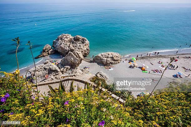 caletilla beach nerja - costa del sol stock photos and pictures