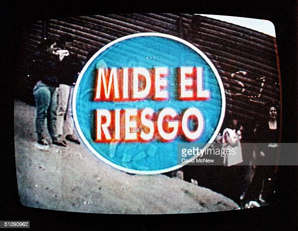 Calexico California A Commercial On Mexican Television Showing People Gathered On The Mexico Side Of The International Border Fence To Cross Into The...