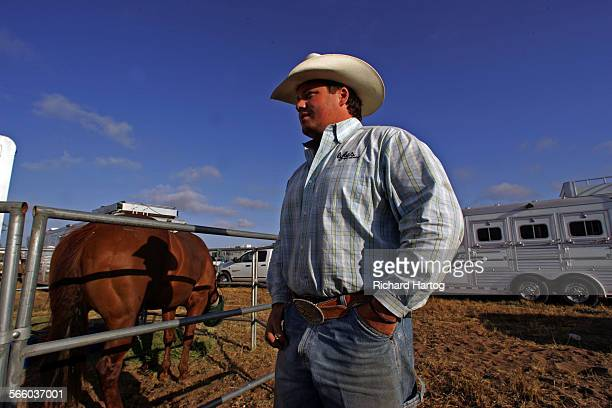 Calf roper Anthony Estep looks over his horses at the Santa Maria Elks Rodeo in Santa Maria Friday May 30 2008 Rodeos are feeling the gas crisis with...