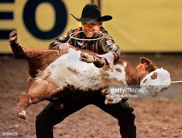 Calf Roper Trevor Brazile of Childress Texas turns a calf at the 1999 National Finals Rodeo in Las Vegas Nevada 06 December 1999 The Rodeo is in its...