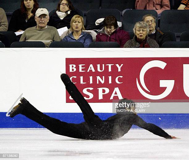 Evan Lysacek of the United States falls during the Men's Qualifying Free Skate program 20 March 2006 at the ISU World Figure Skating Championships...