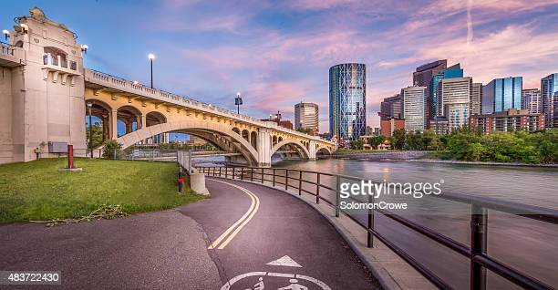 calgary city skyline with center street bridge and bow river - calgary stock pictures, royalty-free photos & images