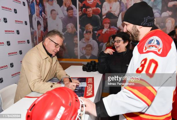 Calgary Flames alumni Mike Vernon signs autographs in The PreGame in advance of the 2019 Tim Hortons NHL Heritage Classic as the Calgary Flames take...