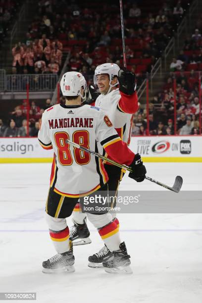 Calgary Flames center Derek Ryan and Calgary Flames left wing Andrew Mangiapane celebrate a goal during the 2nd period of the Carolina Hurricanes...