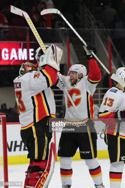 Calgary Flames center Elias Lindholm and Calgary Flames goaltender David Rittich celebrate their win at the end of the 3rd period of the Carolina...