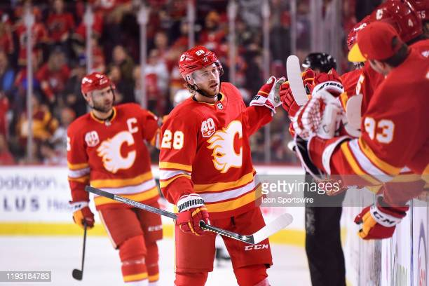 Calgary Flames Center Elias Lindholm celebrates a goal against the Edmonton Oilers with teammates during the first period of an NHL game where the...