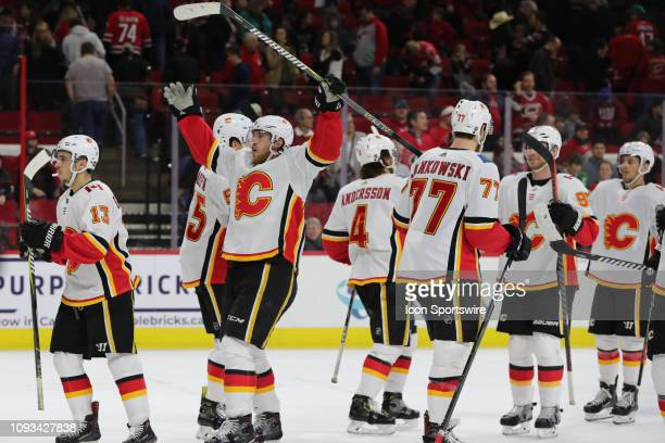Calgary Flames center Elias Lindholm former Carolina Hurricanes player makes fun of the Storm Surge cheer at the end of the 3rd period of the...