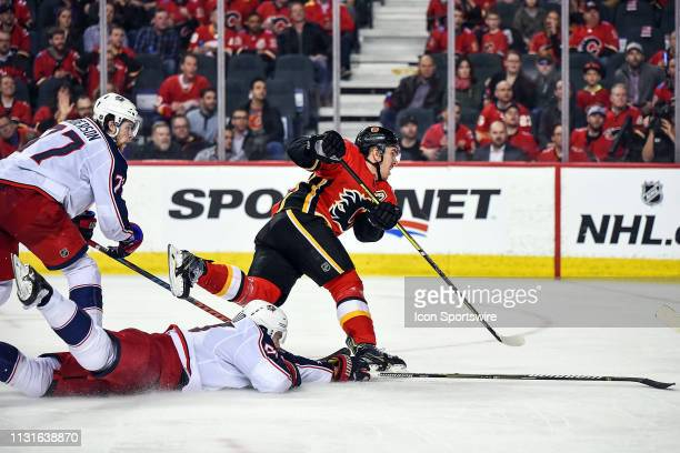 Calgary Flames Center Mikael Backlund attempts a shot on a partial breakaway as Columbus Blue Jackets Defenceman Adam McQuaid and Right Wing Josh...