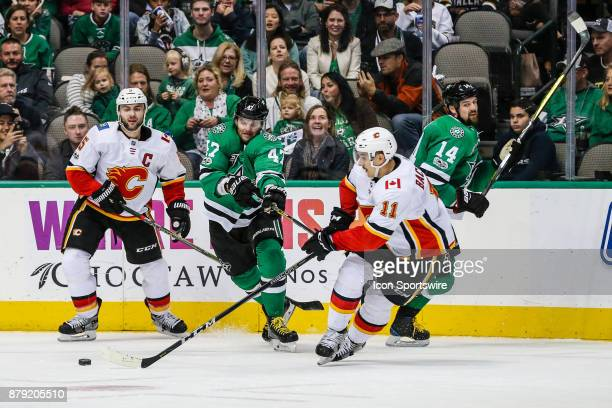 Calgary Flames center Mikael Backlund left wing Tanner Glass Dallas Stars right wing Alexander Radulov and left wing Jamie Benn all chase the puck...