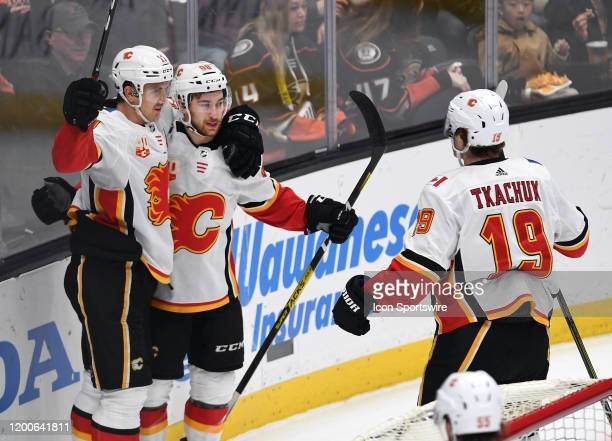 Calgary Flames center Mikael Backlund with Calgary Flames left wing Andrew Mangiapane after Backlund scored a goal in the first period of a game...