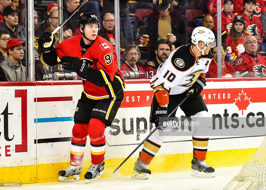 Calgary Flames Center Sam Bennett (93) and Anaheim Ducks Right Wing Corey Perry (10) look for a pass during a game between the Calgary Flames and the Anaheim Ducks on December 29, at the Scotiabank Saddledome, in Calgary AB.