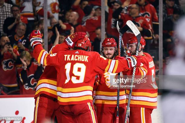 Calgary Flames Center Sean Monahan celebrates a goal with Left Wing Matthew Tkachuk Defenceman Mark Giordano Left Wing Johnny Gaudreau and Defenceman...