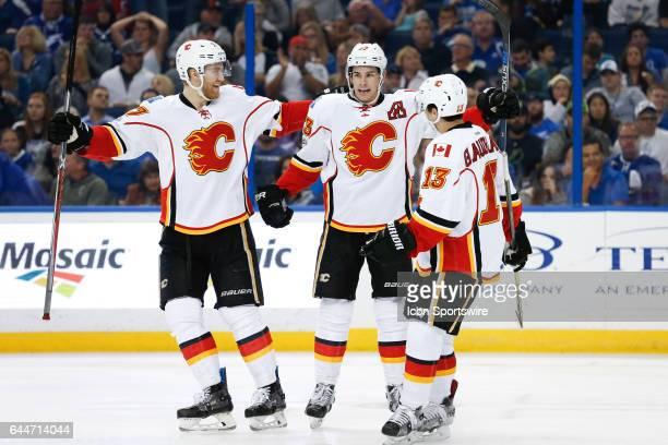 Calgary Flames center Sean Monahan celebrates with Calgary Flames defenseman Dougie Hamilton and Calgary Flames left wing Johnny Gaudreau after...