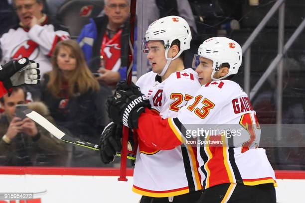 Calgary Flames center Sean Monahan celebrates with Calgary Flames left wing Johnny Gaudreau after scoring during the second period of the National...