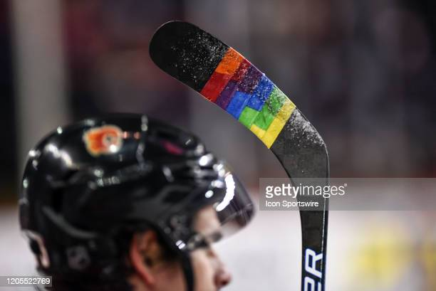 Calgary Flames Center Sean Monahan holds a stick taped in rainbow colours during warmups in support of the NHL's Hockey is for Everyone initiative...
