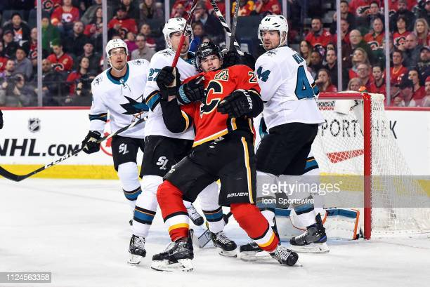 Calgary Flames Center Sean Monahan is pulled down by San Jose Sharks Right Wing Joonas Donskoi during the third period of an NHL game where the...
