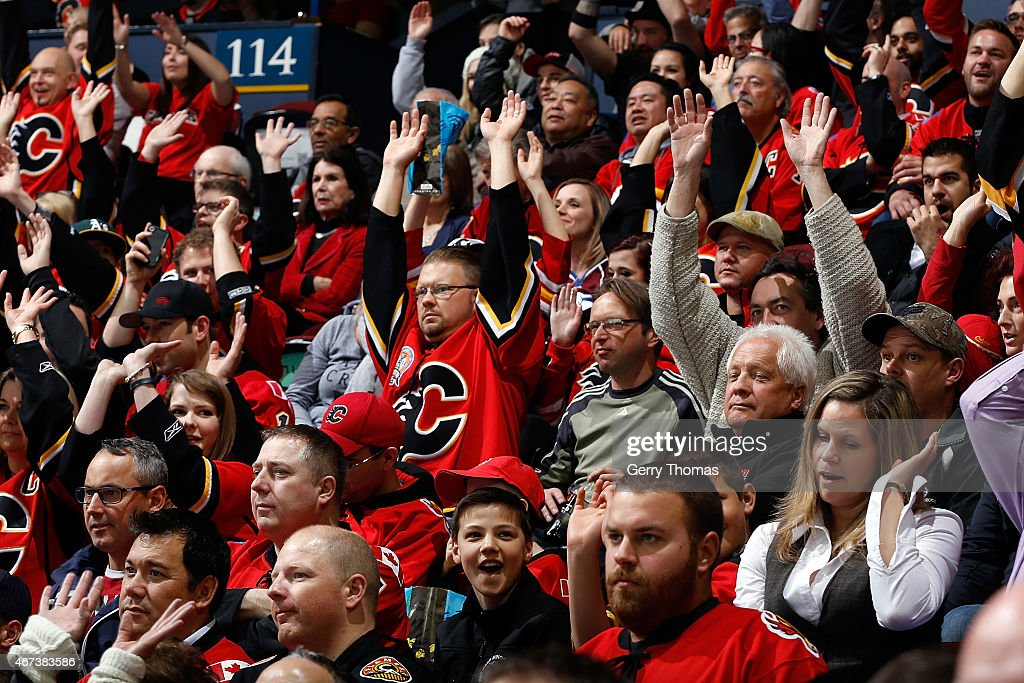Calgary Flames cheer during the game against the Colorado Avalanche at Scotiabank Saddledome on March 23, 2015 in Calgary, Alberta, Canada.