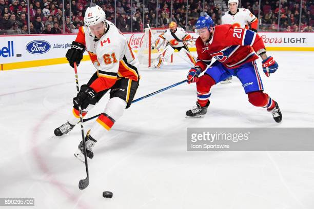 Calgary Flames Defenceman Brett Kulak gets to the puck before Montreal Canadiens Left Wing Nicolas Deslauriers during the Calgary Flames versus the...