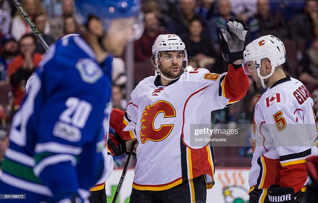 Calgary Flames Defenceman Mark Giordano (5) and Right Wing Michael Frolik (67) celebrate Frolik's third period goal against the Vancouver Canucks during a NHL hockey game on January 06, 2016, at Rogers Arena in Vancouver, BC. Vancouver won 4-2.