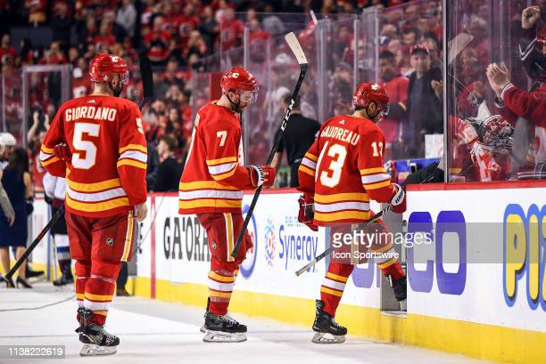 Calgary Flames Defenceman Mark Giordano Defenceman TJ Brodie and Left Wing Johnny Gaudreau exit the ice for the final time as their team's season...