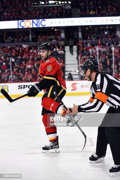 Calgary Flames Defenceman Mark Giordano gets some help from referee Frederick LEcuyer after a stick gets stuck in his skate during the second period...