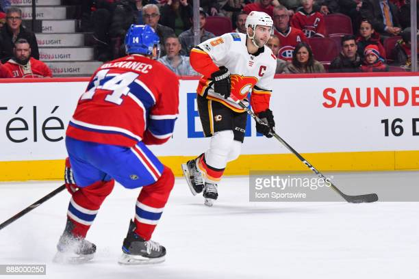 Calgary Flames Defenceman Mark Giordano looks for a pass target during the Calgary Flames versus the Montreal Canadiens game on December 7 at Bell...