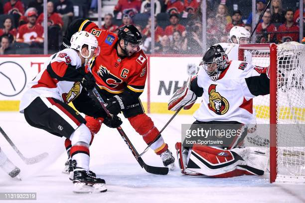 Calgary Flames Defenceman Mark Giordano pushes the puck past Ottawa Senators Goalie Craig Anderson to score a goal during the first period of an NHL...