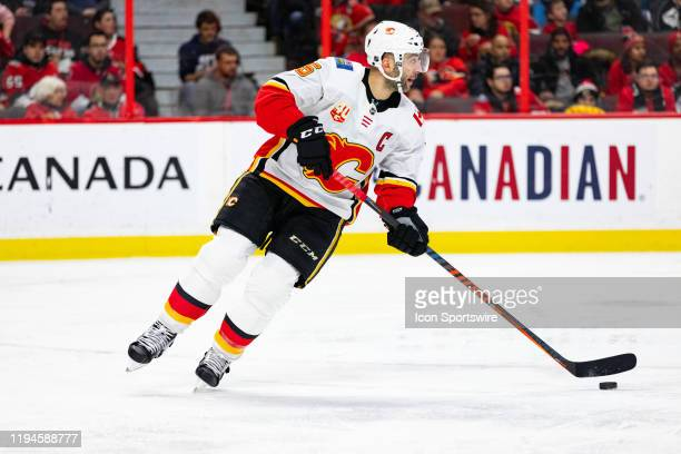 Calgary Flames Defenceman Mark Giordano skates with the puck during second period National Hockey League action between the Calgary Flames and Ottawa...