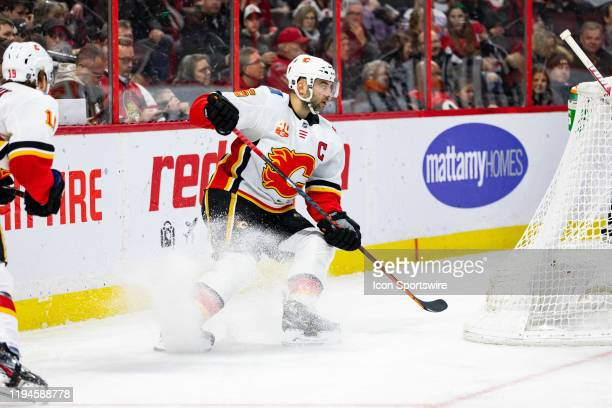 Calgary Flames Defenceman Mark Giordano stops behind the net during second period National Hockey League action between the Calgary Flames and Ottawa...