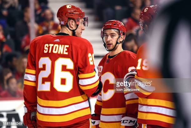 Calgary Flames Defenceman Michael Stone and Left Wing Andrew Mangiapane talk strategy during the third period of an NHL game where the Calgary Flames...