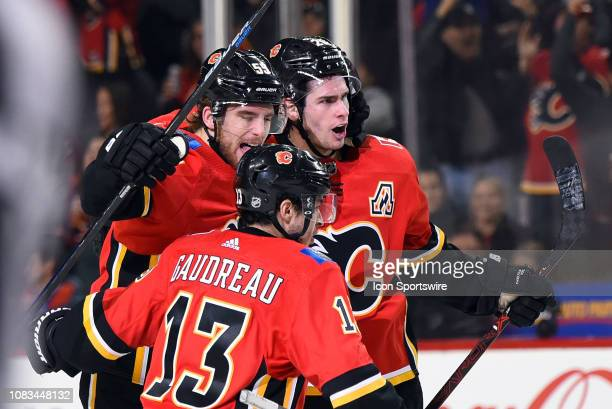 Calgary Flames Defenceman Noah Hanifin celebrates a goal with Center Sean Monahan and Left Wing Johnny Gaudreau during the third period of an NHL...