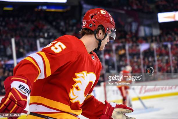 Calgary Flames Defenceman Noah Hanifin flips the puck up to his hand after an icing call during the first period of an NHL game where the Calgary...