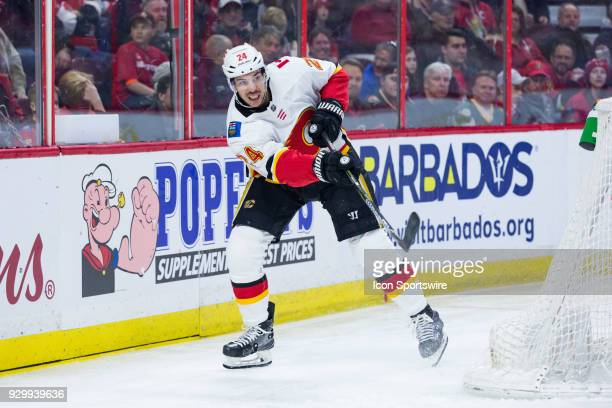 Calgary Flames Defenceman Travis Hamonic follows through on a pass from behind the net during first period National Hockey League action between the...
