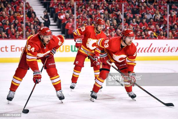 Calgary Flames Defenceman Travis Hamonic Left Wing Johnny Gaudreau and Winger Sam Bennett line up for a faceoff during the first period of Game Five...