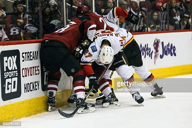 Calgary Flames defenseman Dougie Hamilton gets caught between Arizona Coyotes right wing Tobias Rieder and Arizona Coyotes center Ryan White during...
