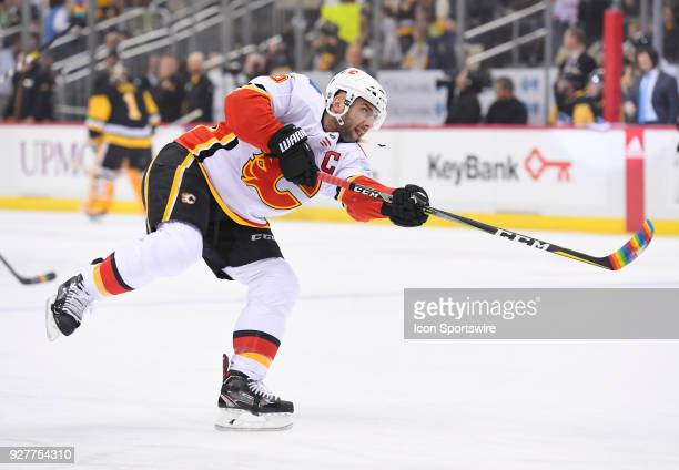 Calgary Flames Defenseman Mark Giordano warms up with a rainbow colored taped stick on 'Hockey is for Everyone' night before the game between the...