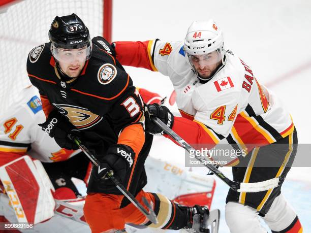 Calgary Flames defenseman Matt Bartkowski gives Anaheim Ducks leftwing Nick Ritchie a shove in the back in the third period of a game played on...