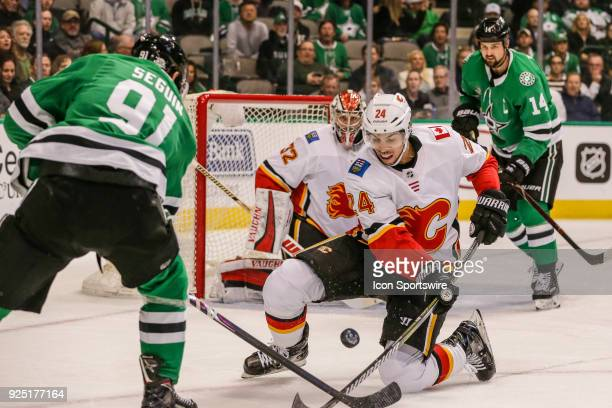 Calgary Flames defenseman Travis Hamonic and Dallas Stars center Tyler Seguin battle for the puck during the game between the Dallas Stars and the...