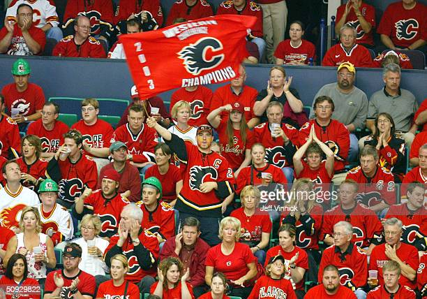 Calgary Flames fan waves a flag amongst a sea of fans during the third period in game six of the NHL Stanley Cup Finals against the Tampa Bay...
