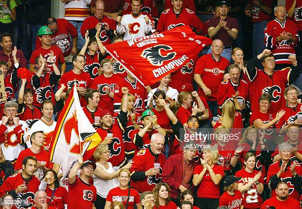 Calgary Flames fans cheer their team on during the second period in game six of the NHL Stanley Cup Finals on June 5 2004 at the Pengrowth Saddledome...