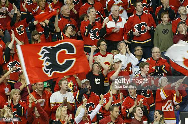 Calgary Flames fans watch Game three of the NHL Stanley Cup Finals against the Tampa Bay Lightning at the Pengrowth Saddledome on May 29 2004 in...
