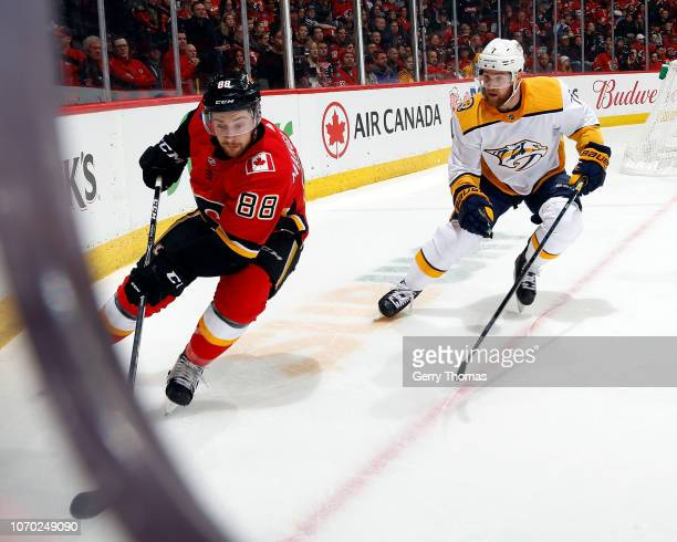 Calgary Flames Forward Andrew Mangiapane and Nashville Predators Defenceman Yannick Weber skate during an NHL game on December 8, 2018 at the...