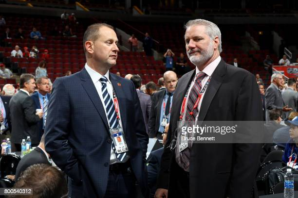 Calgary Flames general manager Brad Treliving and New York Islanders general manager Garth Snow meet during 2017 NHL Draft at the United Center on...