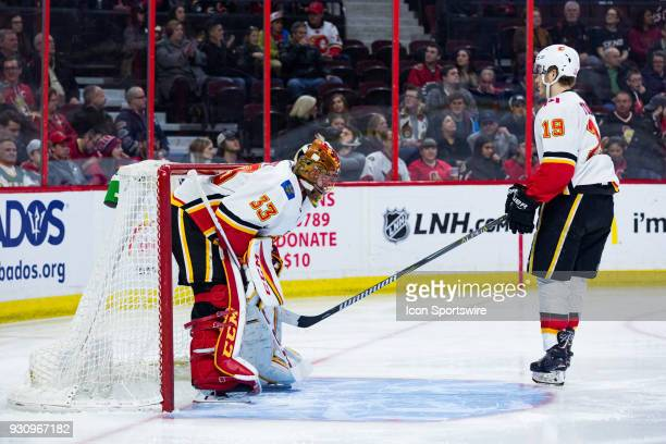 Calgary Flames Goalie David Rittich gets a tap on the pads from Calgary Flames Left Wing Matthew Tkachuk before National Hockey League action between...